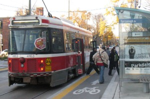 Passengers boarding a TTC streetcar on Roncesvalles Ave., Nov. 2011