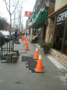 Asphalt patches between tiles on sidewalk is a temporary fix for the winter
