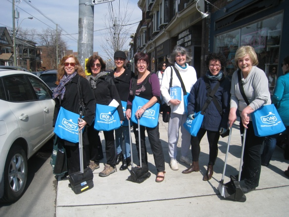 Neighbourhood volunteers launch the RoncyWorks campaign on Roncesvalles Avenue in Toronto.