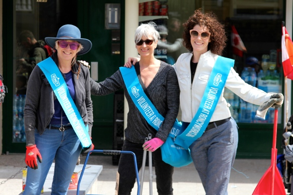 Three members of RoncyWorks enjoying a sunny break on Roncesvalles Avenue during the spring cleanup.